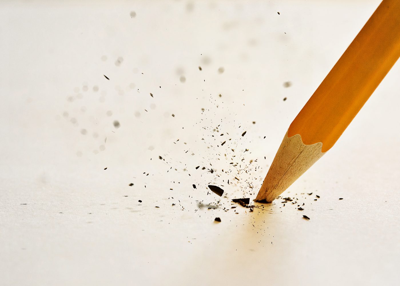 The lead of the pencil breaking after pressing down too hard.